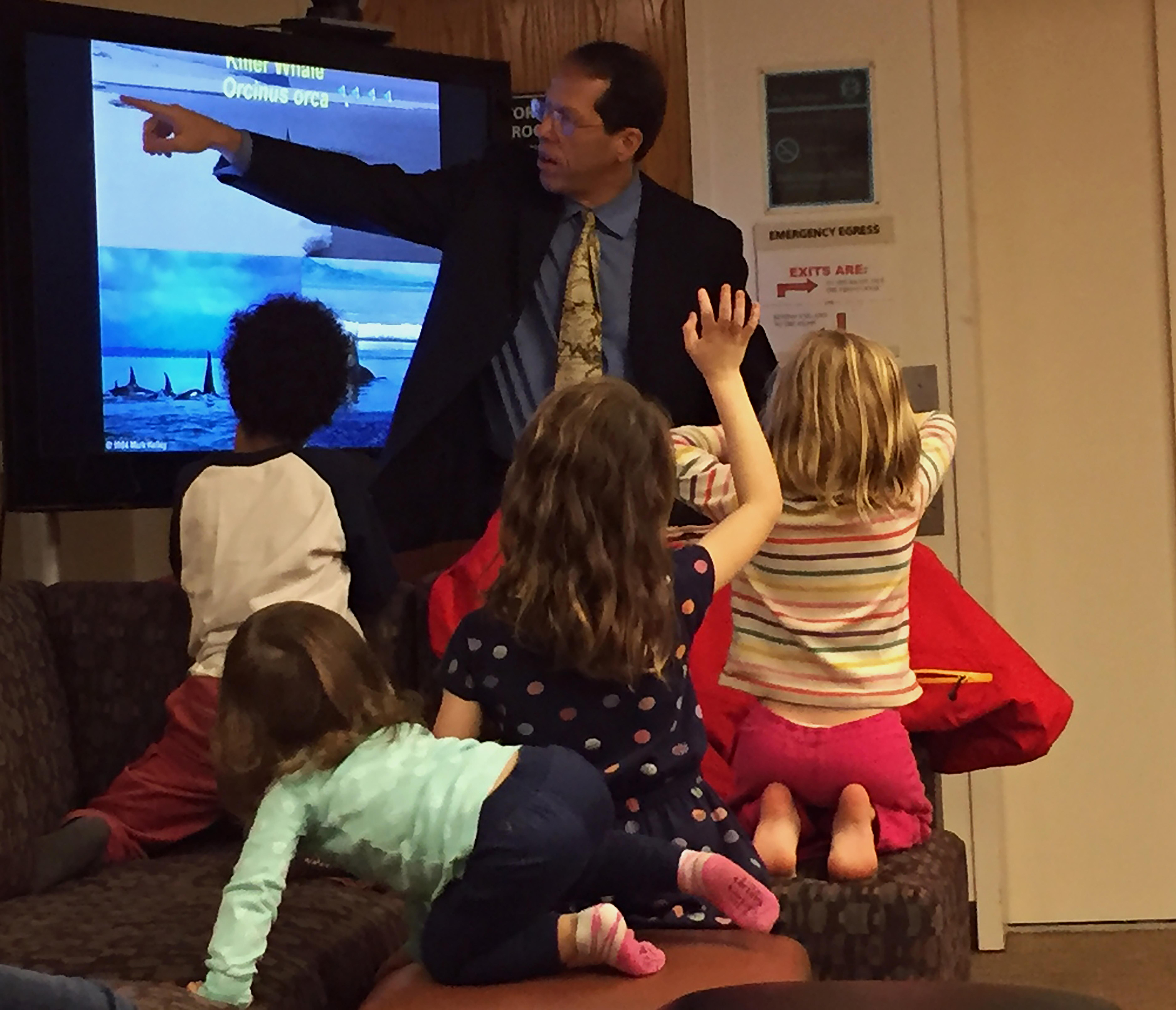 Professor Paul Berkman talking to kids at Ginn Library's Antarctica Day Celebration