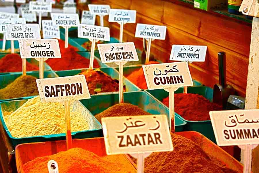 Rows of colorful spices, labeled