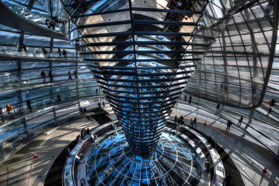 A large mirrored structure inside a multi-storied building