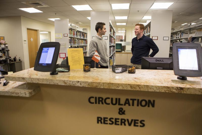 Picture of student workers behind the Circulation Desk